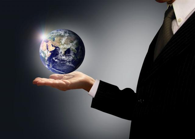 Man in suit holding the Earth