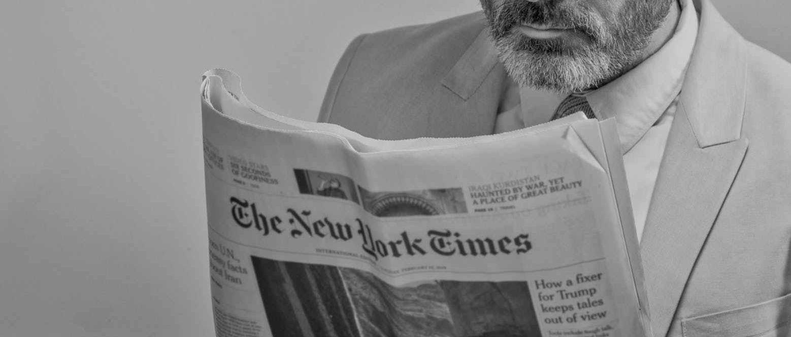 Man Reading New York Times