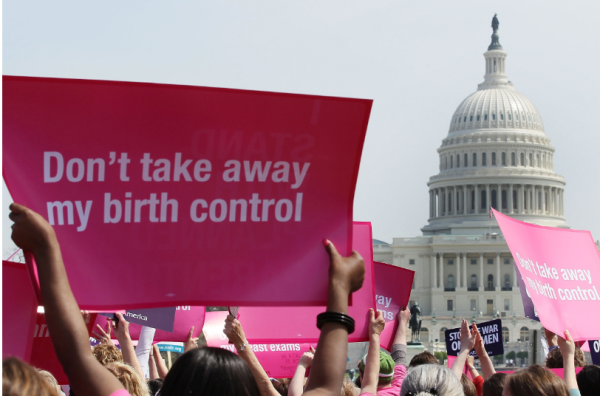"Woman Holding sign ""Don't take away my birth control."""
